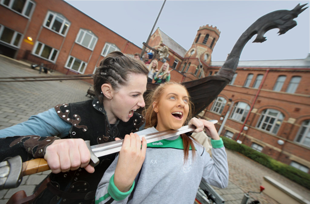 The Vikings are coming! Kyla Kelly is captured by Alison Denvir from the Sea Dragon Viking Community Group, which visited St Mary's University College this week