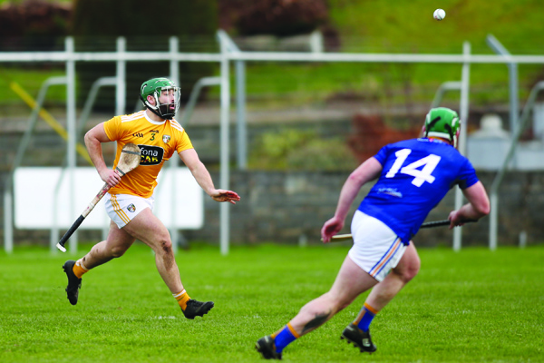 Antrim defender Ciaran Johnston clears his lines under pressure from Wicklow full-forward Andy O'Brien during last Sunday's Division 2A game at Pearse Park, Arklow
