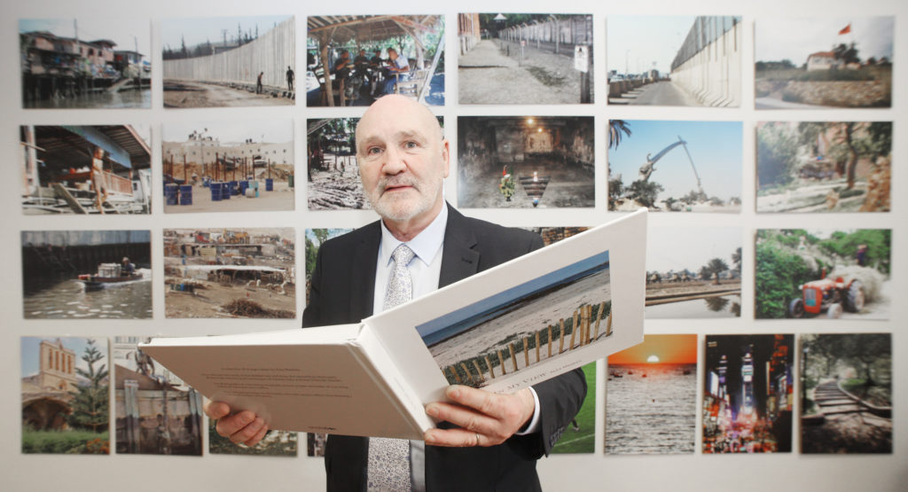 A KEEN EYE: An amateur photographer, Speaker Alex Maskey looks at a collection of photographs that he has taken from over the years