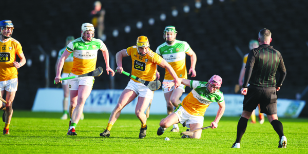 Conor Johnston brushes past Peter Geraghty to gain possession on Sunday. Pic by John McIlwaine