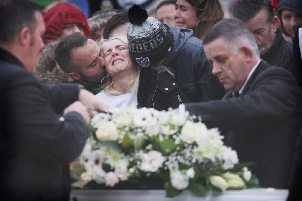 Eoin's mother Lisa is comforted at her son's funeral on Tuesday morning