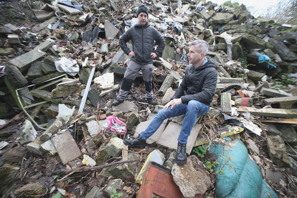 DEVASTATED:Cllr Steven Corr with Milltown resident Junior McKee, who discovered the jaw-dropping extent of dumping on the site