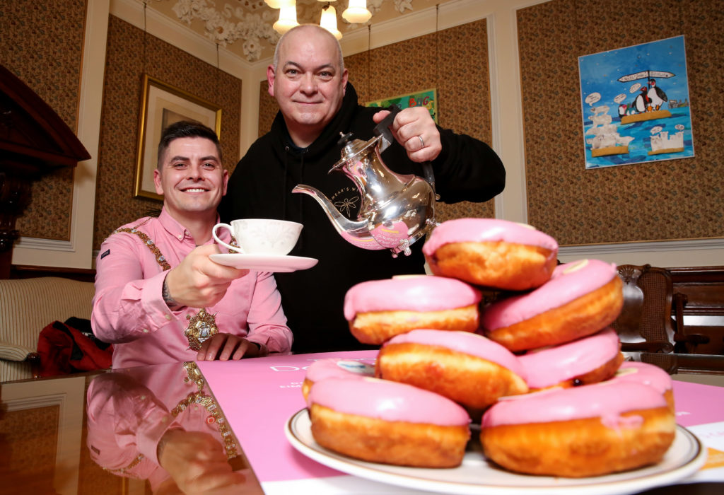 GOING PINK:Seán Smyth pours a cup of coffee for Lord Mayor Danny Baker in the Mayor's Parlour
