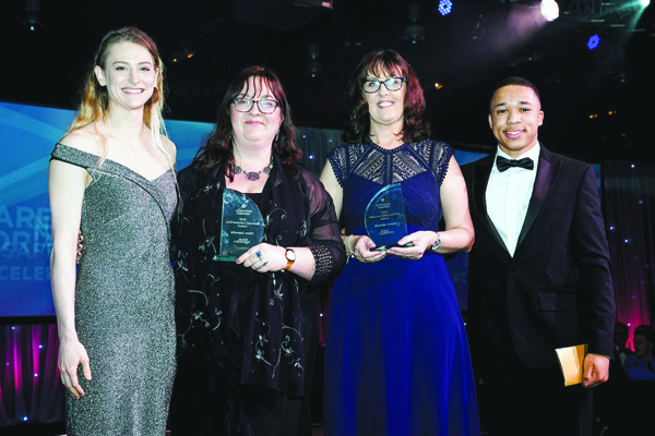 Michele Cowan and fellow National Safeguarding Award winner Clare Saporita pick up their trophies from 2016 Rio trampoline silver medalist Bryony Page and current parallel bars world champion Joe Fraser