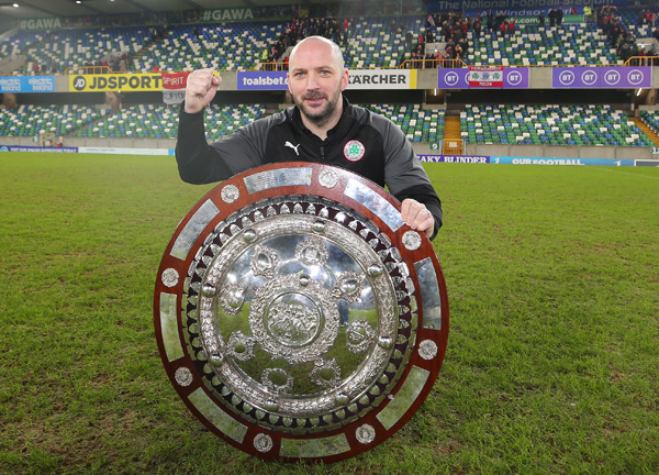 Cliftonville boss Paddy McLaughlin celebrates winning the County Antrim Shield at Windsor Park on Tuesday night