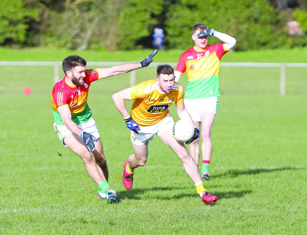 Antrim's Conor Murray, pictured in action against Carlow's Shane Redmond during last Sunday's drawn game at Glenavy, says the Saffrons can't afford another slip-up against Limerick this weekend