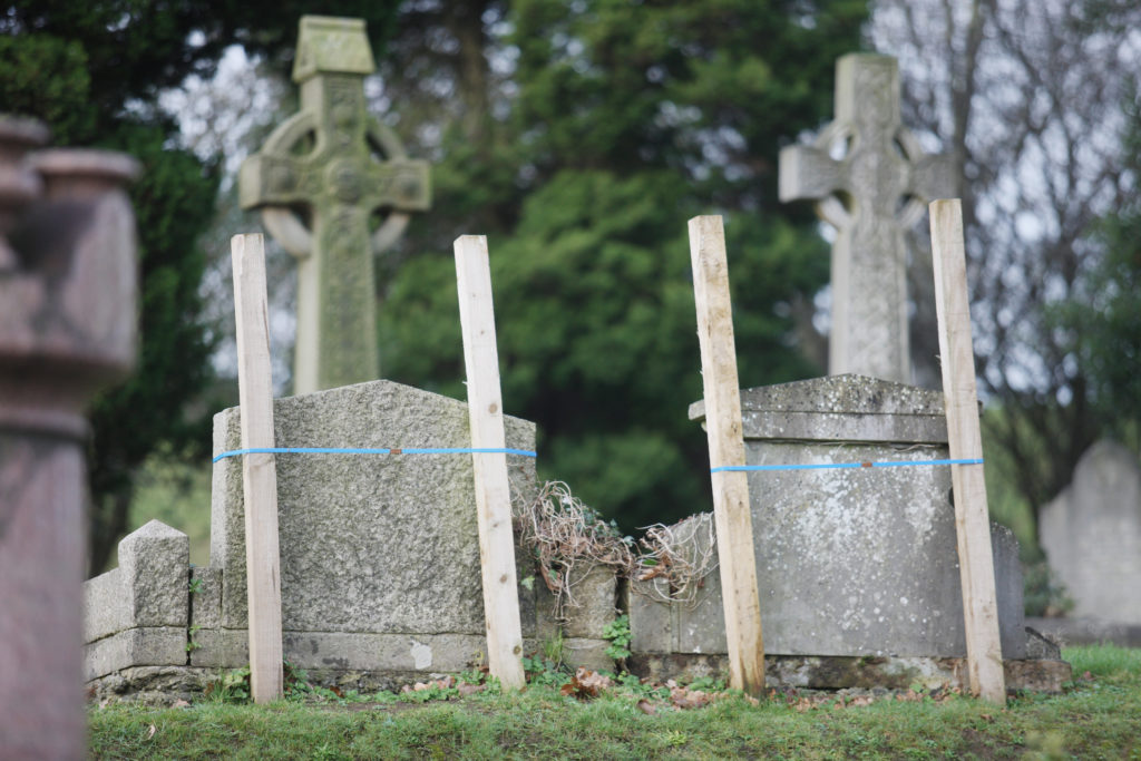 INSPECTION: Scores of graves in the City Cemetery have been marked in this way as needing repair