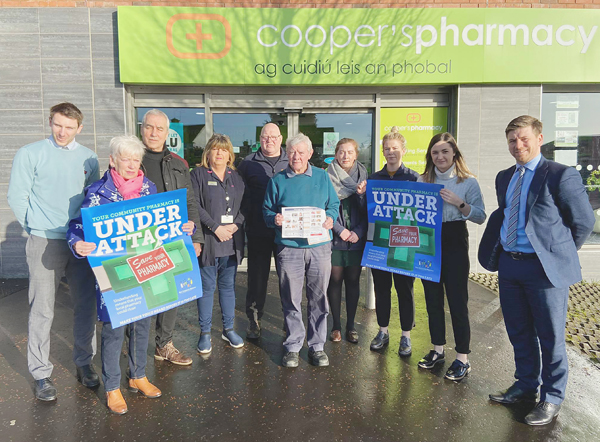 SUPPORT: Michael Cooper and Pat Sheehan MLA with Cooper's staff and customers as the prospect of strike action looms
