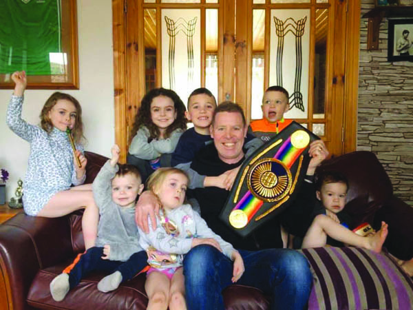 Noel Magee relaxes at his home in Newcastle, Co. Down with his grandchildren and new version of the Commonwealth title belt he was recently presented with