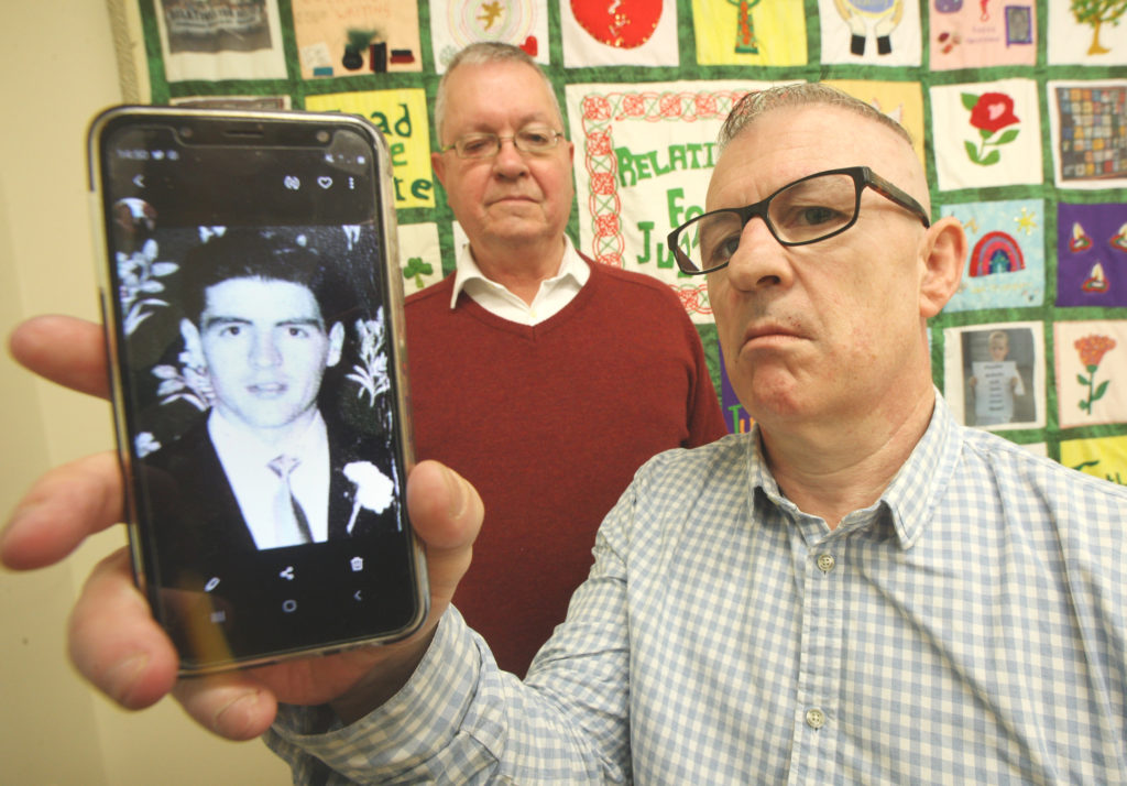 JUSTICE: Stan Carberry with a photo of his father, also Stan, who was shot dead in 1972. Mike Ritchie from RFJ has been working on the case with the Carberry family