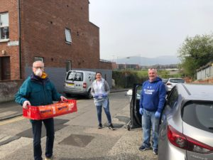 HELPING HAND: Gerry Kelly helping with community food bank deliveries