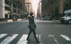 BIG APPLE LIKE NEVER BEFORE: A pedestrian crosses the street in a deserted Manhattan