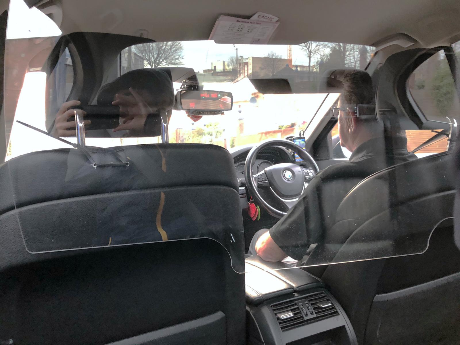 THE NEW NORMAL: A private taxi in North Belfast with a newly-installed protective screen between driver and passengers