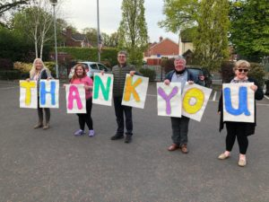 GRATITUDE: Relatives of residents of Ambassador Nursing Home join Noel McCullough to spell out their admiration for care workers