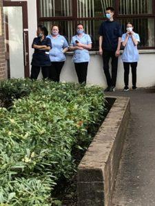HEROES: Staff of Ambassador Nursing Home accept applause