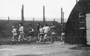 BEHIND THE WIRE: Republican internees jogging in Long Kesh internment camp.