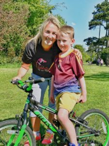 PEDAL POWER: Six-year-old Rossa Doherty, pictured with his mum Caoimhe who is cycling the Falls Park everyday in May, come rain or shine to raise funds for vital PPE for NI Hospice