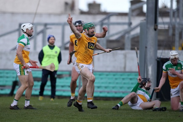 Conor McCann celebrates finding the net in Antrim's last game before lockdown against Offaly