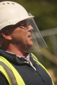 BACK AT IT: A builder on the Clifton Street social housing developmentBuilder waring new face sheilds[/caption]