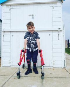 WALKING TALL: Harry Ragless has raised £2,400 with the help of his father and his walking frame and leg supports[/caption]