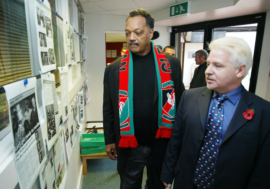 BELFAST GREETINGS: Rev Jesse Jackson pictured here (sporting a Glens scarf) in 2004 visiting East Belfast at the invitation of Sammy Douglass