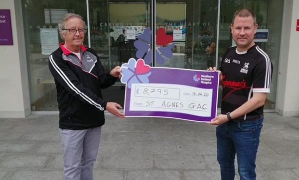 St Agnes' chairman Frank Caldwell with Chris Ward handing over a cheque for £8795 to the NI Hospice following the club's 'Get Fit for the Hospice Challenge'