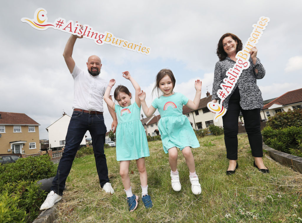 CURTAIN UP ON FUNDING WINDFALL: Tony Devlin joins his twin girls Éirinn and Róise to celebrate bursary boost with Partnership Board CEO Geraldine McAteer