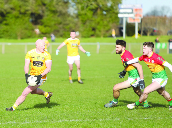 Antrim manager Lenny Harbinson believes that players like Paddy Cunningham (pictured in action against Carlow) will have unfinished business with the county team following the disruption to the season following the Covid-19 outbreak