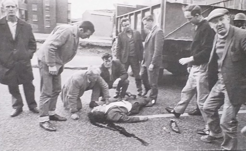 CURFEW VICTIM: Charles O'Neill lies dying after being run over by a British Army vehicle during the Falls Curfew of 1970.