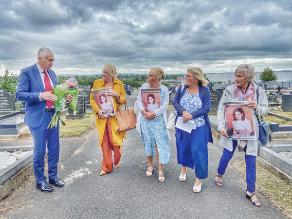 Former police chief Jon Boutcher who is heading the investigation into the killing of Jean Smyth Campbell joins her sisters Margaret McQuillian, Pat Smith, Anne Silcox and Sheila Denvir in Milltown Cemetery
