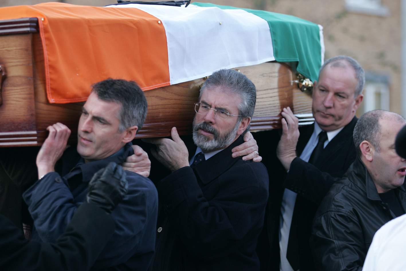 TRIBUTE: Gerry Adams and Bobby Storey (back) help shoulder the coffin of republican activist Martin Meehan in 2007.