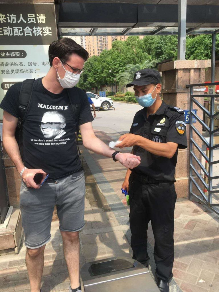 BLACK LIVES MATTER: Seán Ó Garmaile has his temperature checked before he enters his apartment complex. The same guard will also scan his QR code.