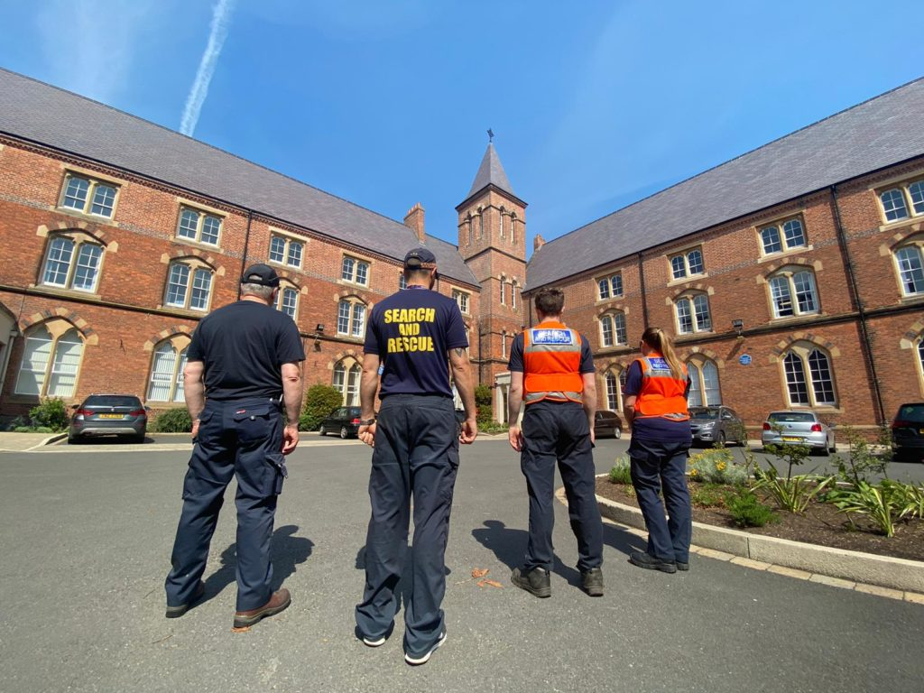 SEARCH TEAM: A Search and Rescue team at St Malachy's College this morning.