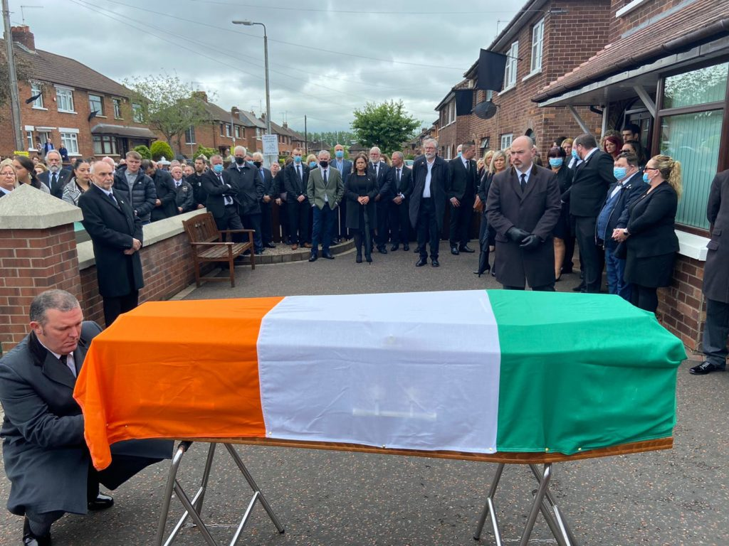 LAID TO REST: The coffin of Bobby Storey is draped in the Tricolour outside his home.