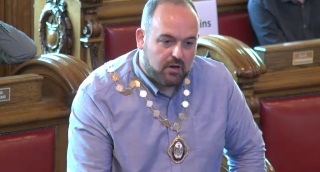 HIGH OFFICE: Paul McCusker of the SDLP makes remarks after his election as Deputy Lord Mayor of Belfast on Monday night.