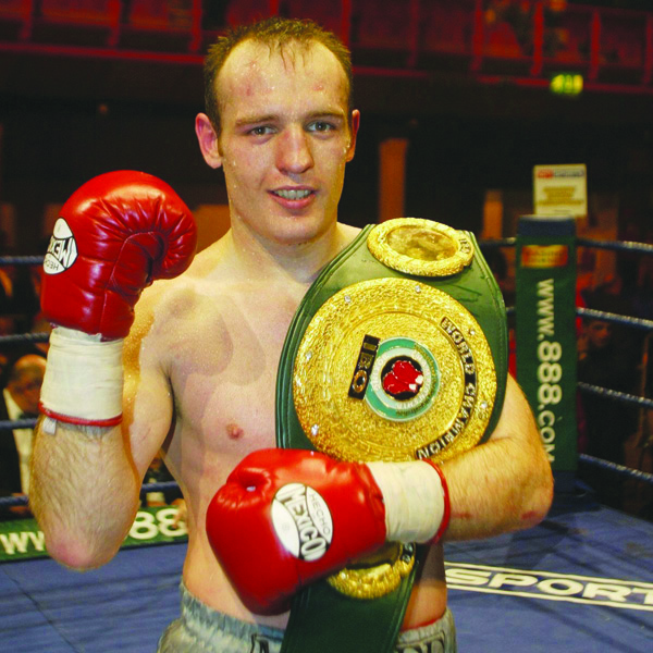 Magee with the IBO title belt
