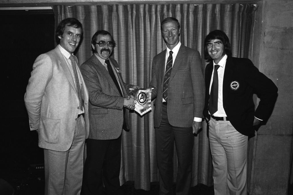 FLASHBACK: Jack Charlton visits Andersonstown Leisure Centre in 1980 and receives a memento of his visit from staff.[/caption]