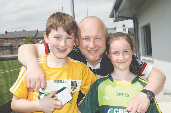 Ardoyne and Bríd Og coach Conor Barnes with his children