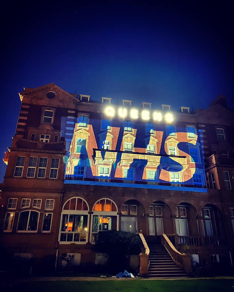 THERE FOR YOU: Queen's Hotel lit up for NHS and (below) preparing food in the kitchen.