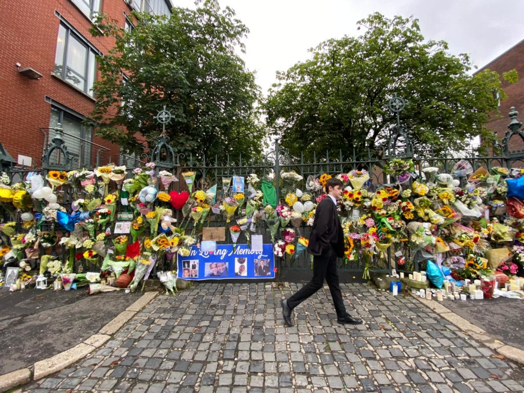 OUTPOURING: Floral tributes left at gates of St Malachy's College.
