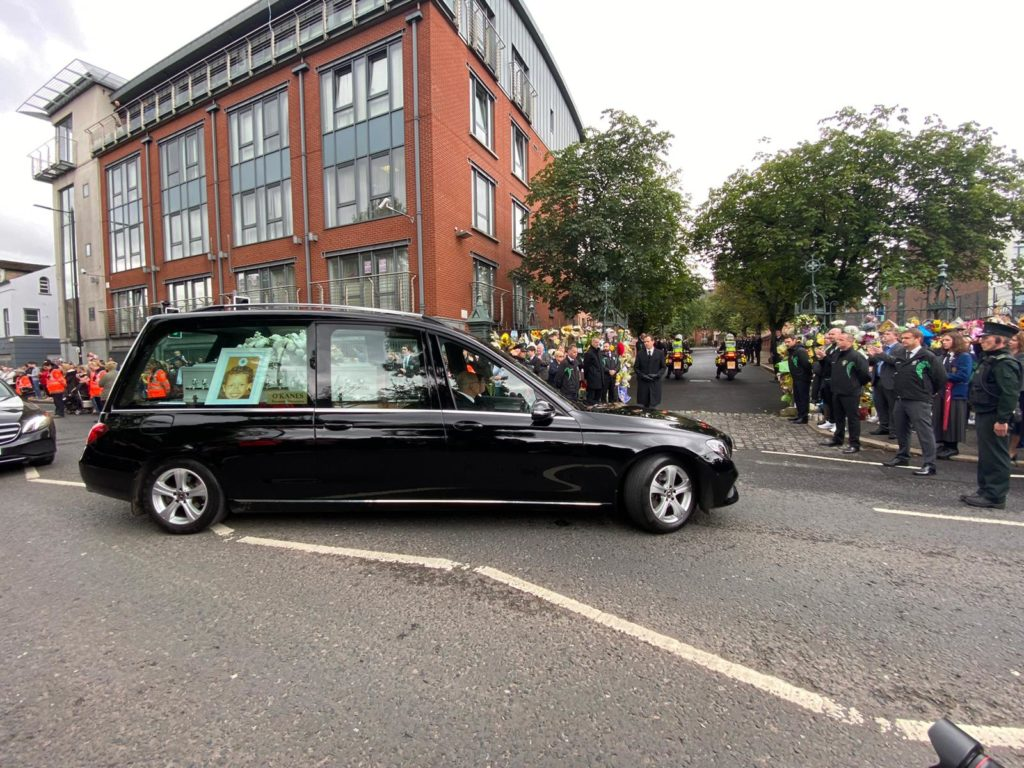 SALUTE: Noah Donohoe's cortege is greeted with applause as it arrives at St Malachy's College